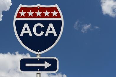 A photo of a road sign indicating that the ACA is to the right.
