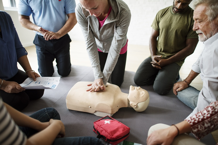 A photo of a a CPR demonstration as part of a wellness program.