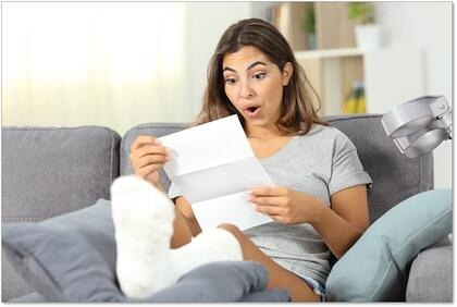Surprised disabled woman reading a medical bill