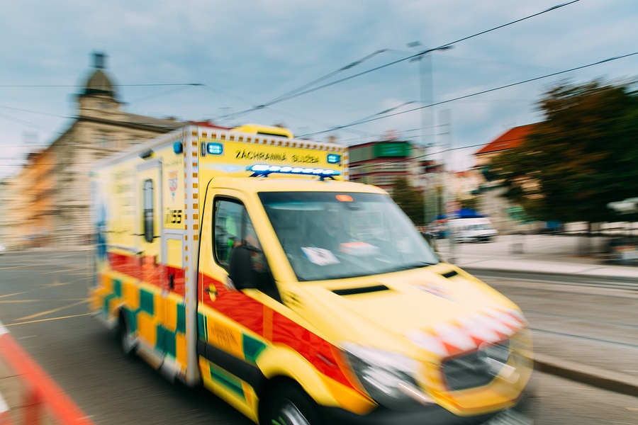 A photo of an ambulance racing through the streets of Europe.