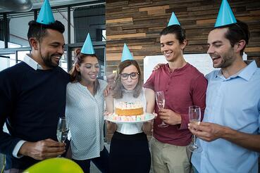 A photo of coworkers celebrating someone's birthday.