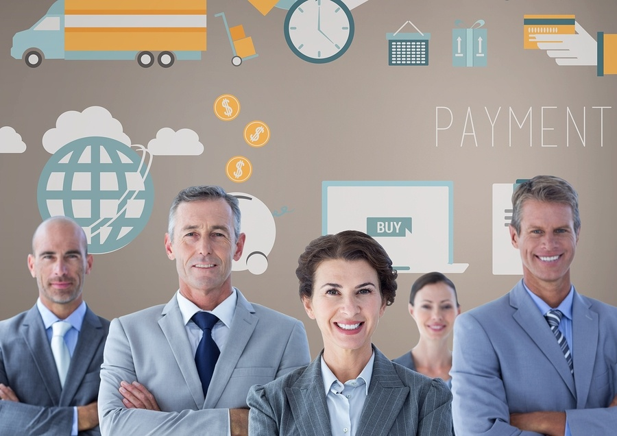 A photograph of businessmen and women with their arms crossed, smiling in front of business related graphics.