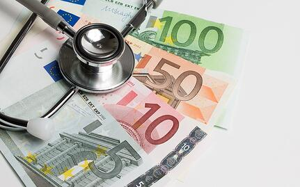 A photo of European currency with a doctor's stethoscope.