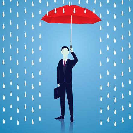 A cartoon image of a man holding an umbrella up to protect himself from rain.