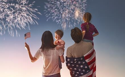An image of a family enjoying 4th of July fireworks.