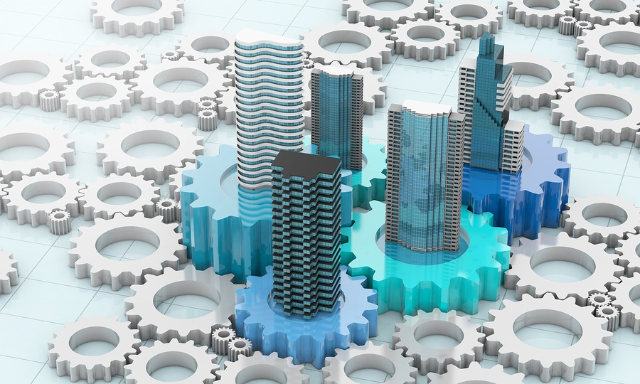 An image of a few blue gears with buildings on top surrounded by plain white gears with nothing on top.