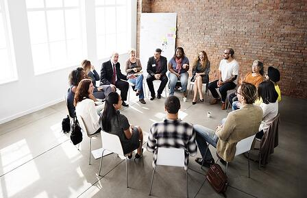 A photo of a small group session for workplace harassment training.