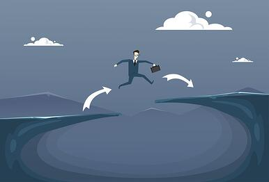 A cartoon image of a man wth a briefcase jumping over a gap.