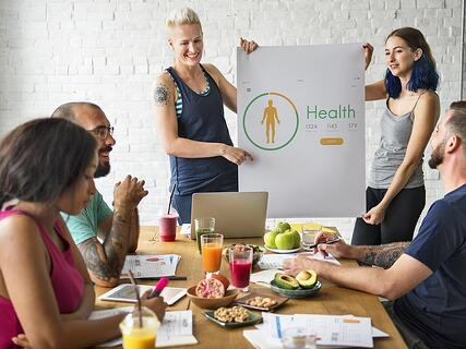 A photo of a wellness presentation at an employee meeting.
