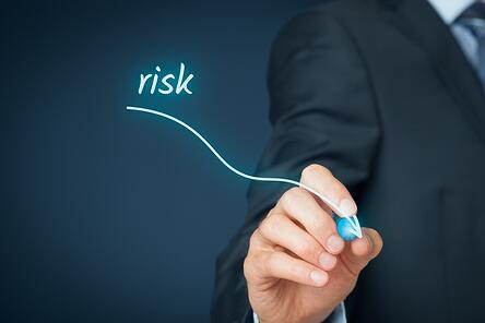 An image showing a person drawing a line sloping downward, indicating decreased risk with level funded health plans.