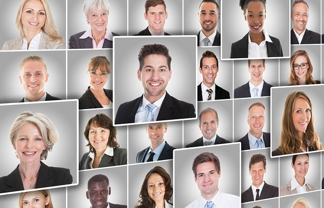 Photo collage of corporate head-shots of employees in varying ages, sex, and ethnicity.