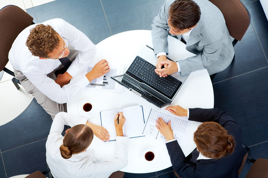 A photo of a group meeting with an employee benefits broker.