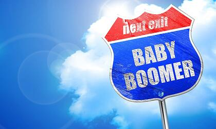 """An image of a road sign that says, """"Next Exit, Baby Boomer."""""""