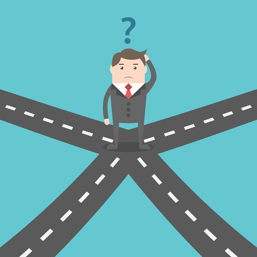 A cartoon image of a man at a crossroads, trying to make a decision of which way to go.